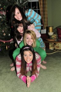 Is there anything better than giggly girls in onesies around the Christmas Tree?