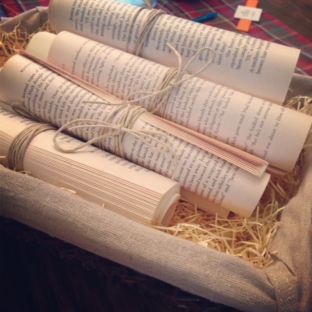 Rolled scrolls from old books make a great decoration for a book lover!