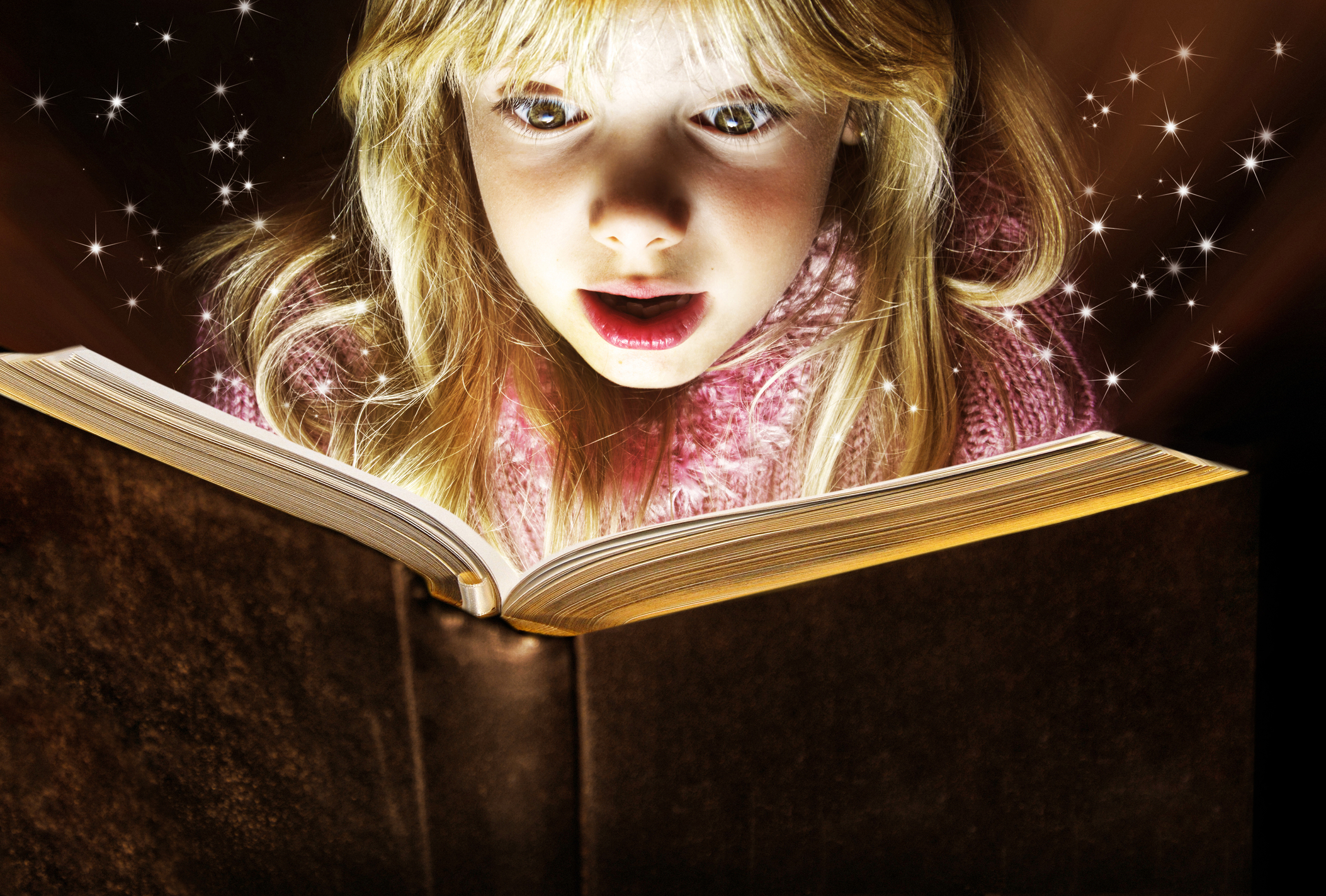 Girl reads magical books